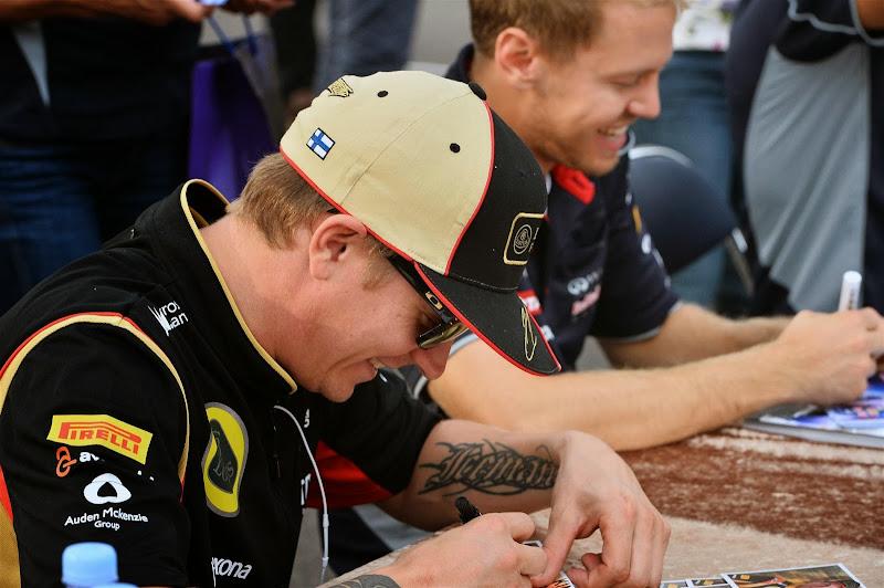 Кими Райкконен и Себастьян Феттель на автограф-сессии Гран-при Кореи 2013