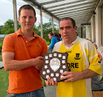 Padraig McGuigan presenting Clontibret's Wayne Leonard with the over 35's shield.