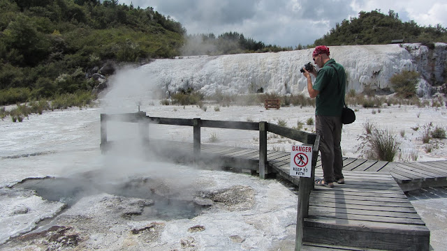 Erik photographing the silica-covered terraces of Orakei Korako.