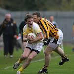 Clontibret's captain Dessie Mone gets the ball depite pressure from John McEntee.  Photo by Philip Fitzpatrick.