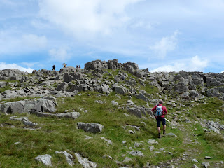 Nearing the top of Harrison Stickle ... several walkers can be seen at the summit.