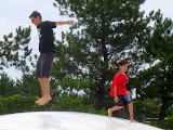 Enjoying the giant curvy trampolines at Uminonakamichi Seaside Park