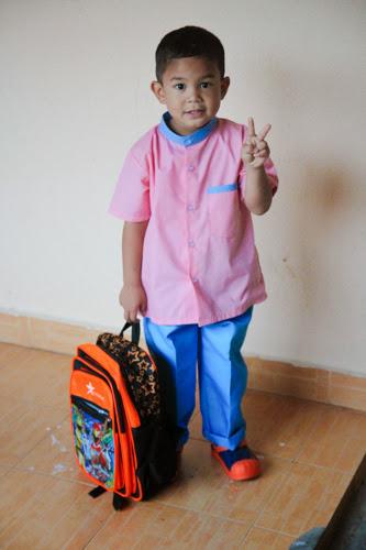 aslah sudah bersedia hendak ke sekolah