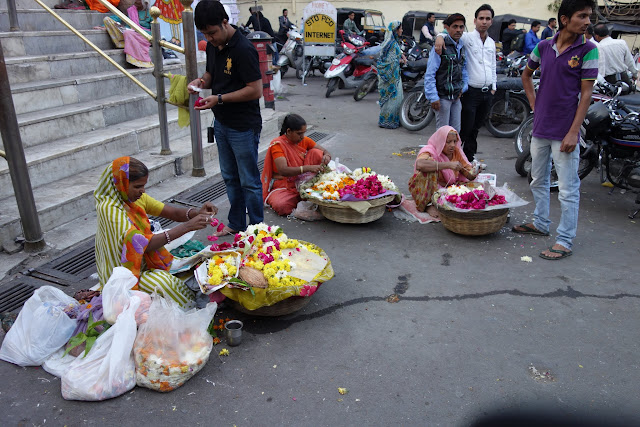 Women selling offertory flowers outside a temple in Udaipur.
