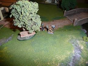 Dwarves approach a coffin