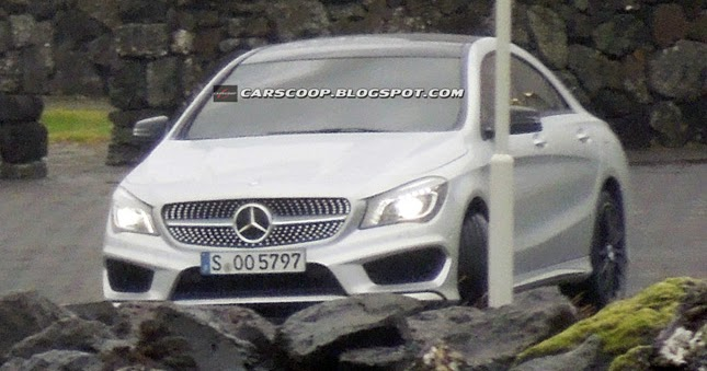 New mercedes benz cla compact four door coupe caught for Mercedes benz compact car