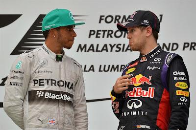 Льюис Хэмилтон и Себастьян Феттель на подиуме Гран-при Малайзии 2014