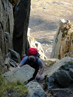 Climbing up a very steep chimney