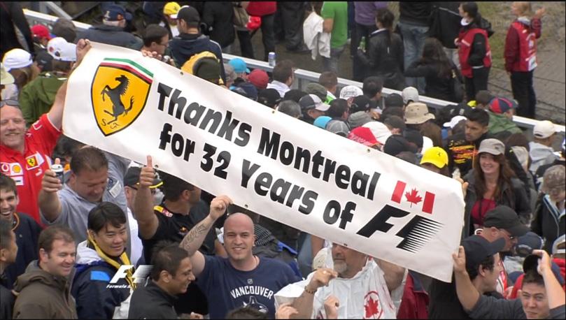 Монреальские болельщики Ferrari и Формулы-1 на Гран-при Канады 2011 с плакатом