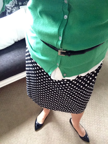 Fashion Friday green cardigan with black and white polka dot skirt