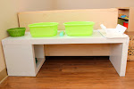 This station in our toddler rooms enables children to wash their own dishes. (We afterwards santize them in a dishwasher, of course.)