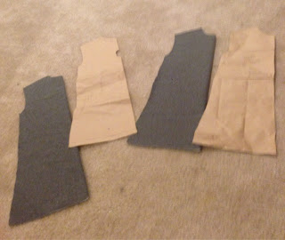 Cutting the fabric for the tunic.