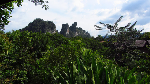 Dramatic limestone formations as seen from Khao Sok village.