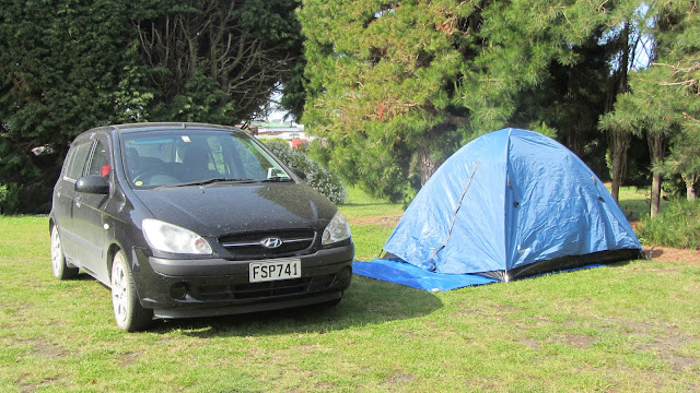Setting up camp next to our Jucy rental car just outside Oamaru.