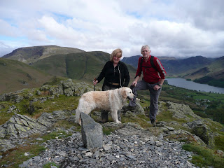 Ann and Roger at the southern summit of Rannerdale Knotts - aha a new cairn in the making!