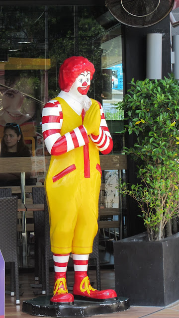 "Ronald McDonald in Khao Lak demonstrating the Thai ""wai"" gesture (hands clasped together)."