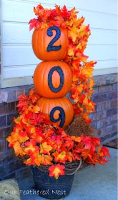 outdoor fall decorating, pumpkins, leaves, house number pumpkins