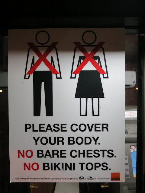 A sign reminding tourists to observe Lao modesty.