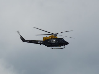 A helicopter patrols overhead