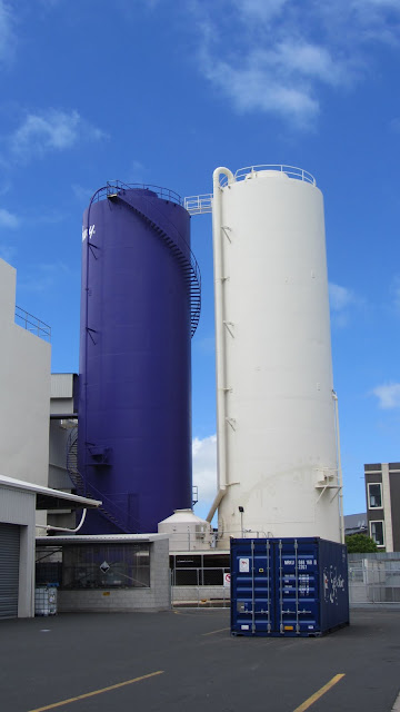 Trademark purple and white storage silos at the Cadbury factory.