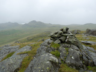 Broad Crag Summit in the pouring rain.