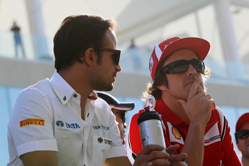 Витантонио Льюцци и задумчивый Фернандо Алонсо на параде пилотов Гран-при Абу-Даби 2011