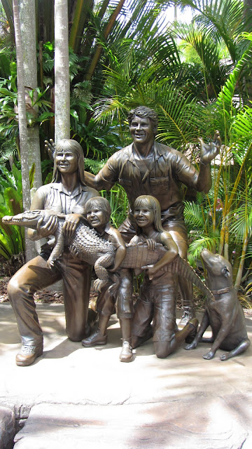 A statue of Steve Irwin and family. Photos and memorabilia of the Crocodile Hunter fill the park.