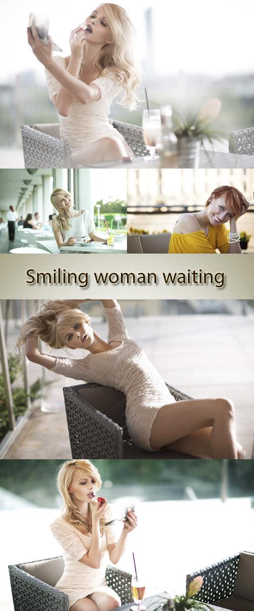 Stock Photo: Smiling woman waiting