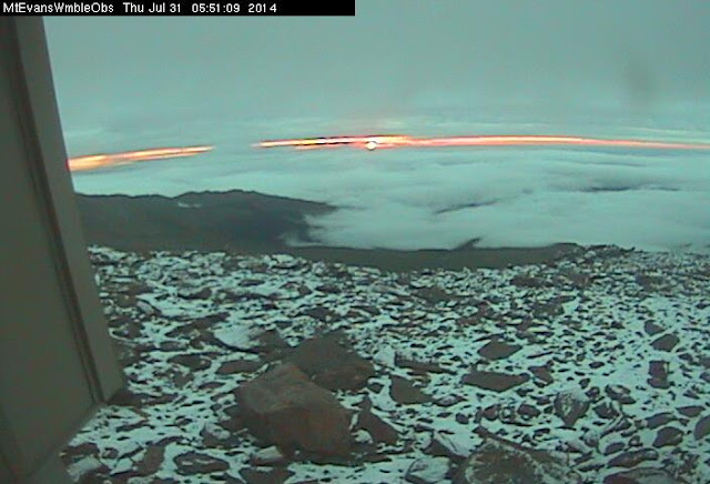 July 31, 2014 - Sunrise snow on Mount Evans. (DU Observatory)