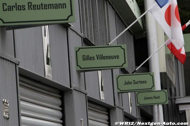 таблички над боксами: Карлос Ройтеман, Жиль Вильнев, Джон Сертис, Джеймс Хант на Нюрбургринге во время уикэнда Гран-при Германии 2011