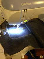 Embroidering the design for the front of the tunic.