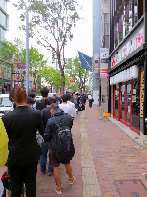 The line for buying a new iPhone at the Fukuoka Apple store wrapped around the block