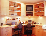 Mieske Home Office - This home office features two work stations, as well as a place to display the client's sports memorabilia, TV and VCR. The custom cabinetry is natural maple.