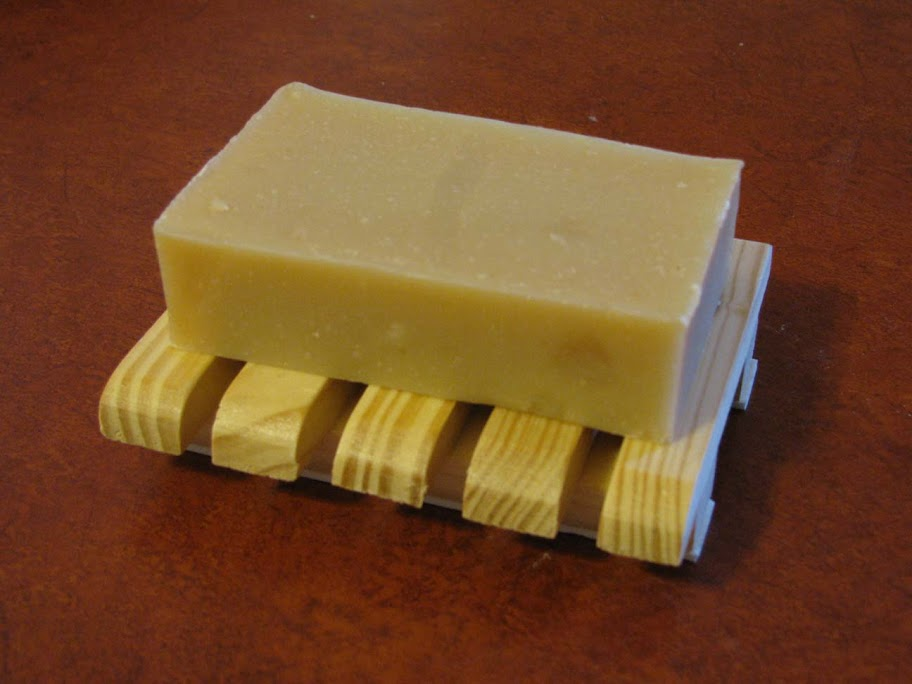A Rectangle Bar of our Goat's Milk Soap on a Wooden Soap Dish
