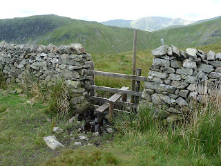 A stile we crossed before ascending by the wall to Birkett Fell.