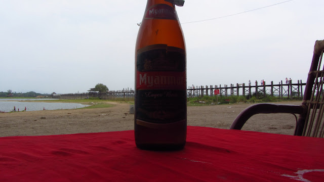 Enjoying a Myanmar Beer near the bridge.