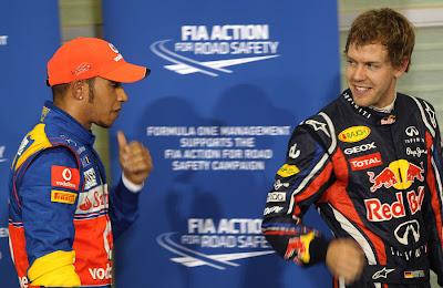 Льюис Хэмилтон и Себастьян Феттель после квалификации на Гран-при Абу-Даби 2011