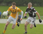 Clontibret's Conor McManus gets passed Magheracloone's Michael Jones in their Gormley's uPVC Monaghan Senior football championship game at Aughnamullen.  Pic Philip Fitzpatrick.
