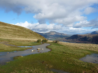 Pools of water from the rain in previous days. Blencathra can be seen in the distance.