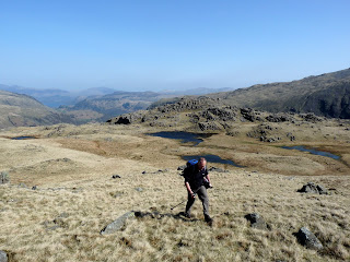 Leaving Wainwrights summit of Seathwaite Fell.