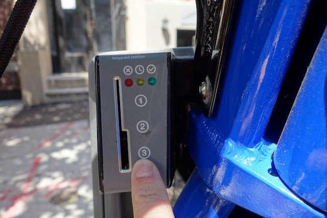 A 5-digit code is used to unlock the bike from the dock. Annual pass holders can use a key card.
