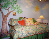 Khamilah's Bedroom 1 of 2 - This little girl's bedroom features a mural that creates a garden atmosphere. The bedding is all reversible, allowing the child to create many looks.