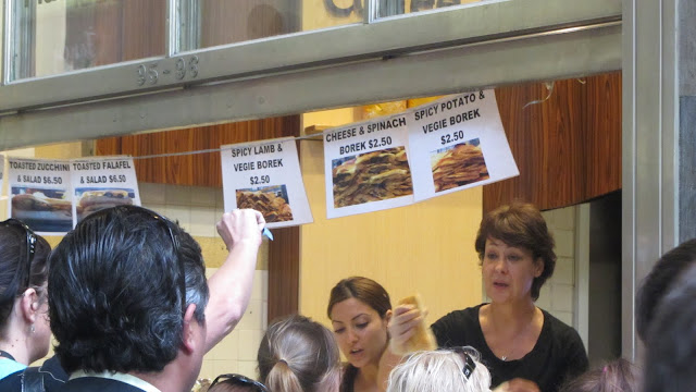 A hungry crowd jostling for yummy borek sandwiches.