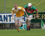 Clontibret's Ned McCann and Inniskeen's Barry McArdle in action in the Silver Hill Foods Shield Hurling Final at Monaghan. ©Catherine McAviney/movingimages.ie