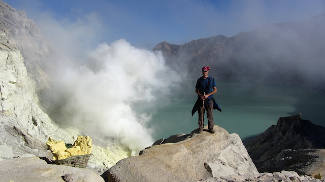 At Kawah Ijen's crater rim. The sulfur gasses seen at left are trapped and condensed to form solid sulfur.