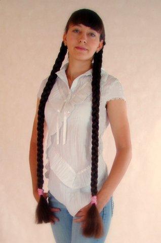 girls with super long hair: elegant long heavy twin braids