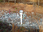 A completed passive landfill gas vent trench and monitoring well at a landfill