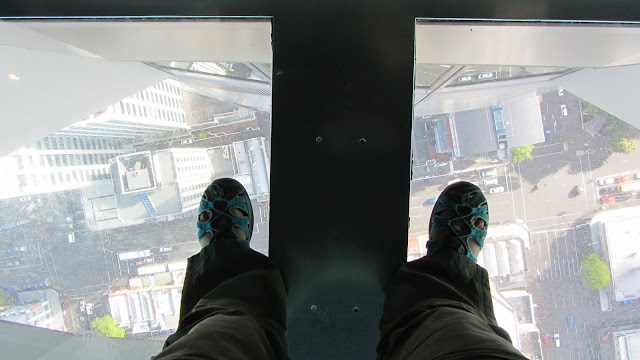 Standing over the glass floor at the Sky Tower.
