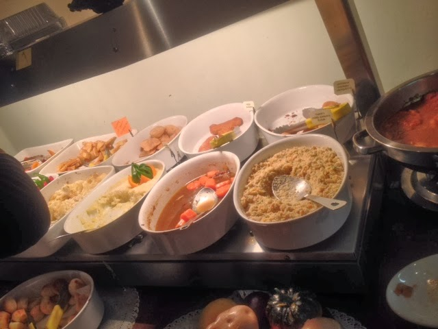 Bowls of sides at Nabrasa London's buffet counter