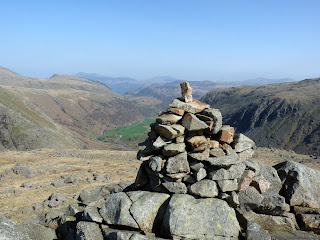 The Wainwright Cairn on Seathwaite Fell. Borrowdale and Derwentwater are in the distance.